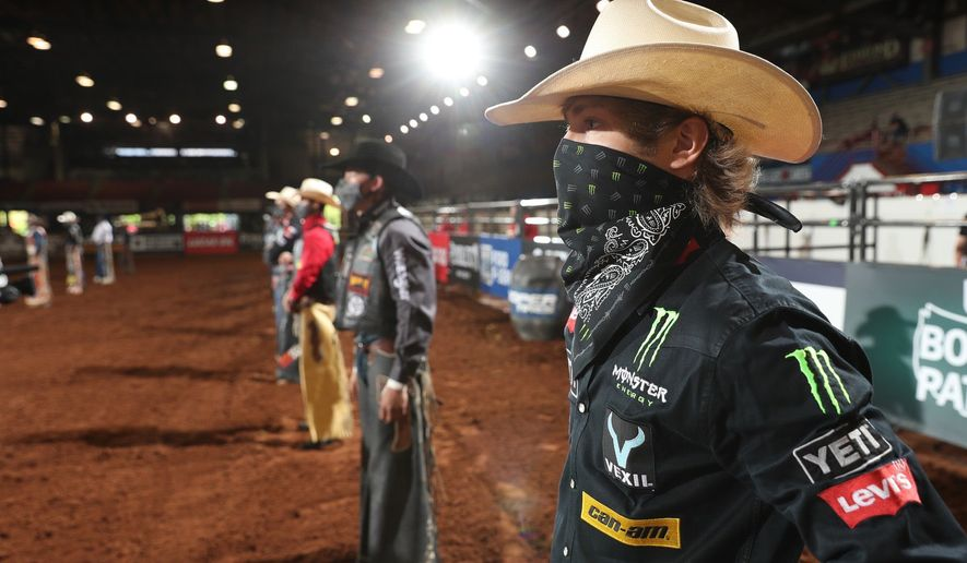 Rider introductions/national anthem while social distancing. PBR (Professional Bull Riders), on hiatus the past five weeks, returned to competition this weekend, in a closed event at the Lazy E Arena in Oklahoma. (Photo courtesy of Professional Bull Riders) ** FILE **