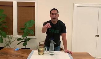 "In this April 11, 2020 image from video, Kauai Mayor Derek Karakami introduces his latest ""Stay Home, Kauai"" video aimed at keeping his county informed and entertained after implementing a curfew to help curb the spread of coronavirus. (Derek Kawakami via AP)"