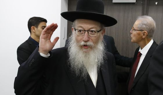 FILE - In this Feb. 23, 2020 file photo, Israeli Health Minister Yaakov Litzman arrives for a a situation assessment meeting with Prime Minister Benjamin Netanyahu and others regarding the Coronavirus, in Tel Aviv, Israel. Litzman said Sunday, April 26, 2020, that he is stepping down following a public uproar over his handling of the coronavirus crisis and his own COVID-19 infection. He said that he will take over as Construction Minister once a new government is formed. (Jack Guez/Pool via AP, File)
