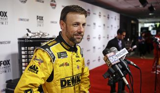 In this Feb. 22, 2017, file photo, Matt Kenseth answers questions during NASCAR Daytona 500 media day at Daytona International Speedway in Daytona Beach, Fla. Former NASCAR champion Matt Kenseth will once again come out of retirement to compete for Chip Ganassi Racing as the replacement for fired driver Kyle Larson. Larson lost his job two weeks ago for using a racial slur while competing in a virtual race.  (AP Photo/John Raoux, File)  **FILE**