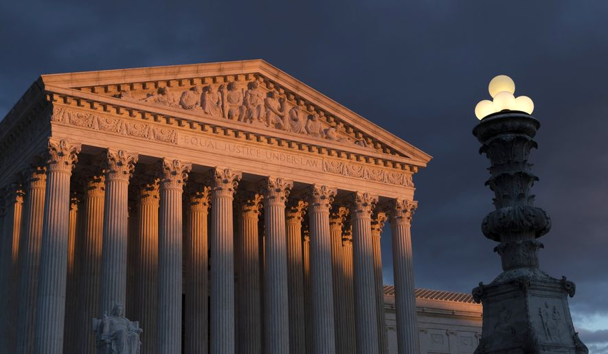 In this Jan. 24, 2019, file photo, the Supreme Court is seen at sunset in Washington. (AP Photo/J. Scott Applewhite) **FILE**