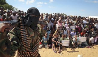 An armed member of the militant group al-Shabaab attends a rally on the outskirts of Mogadishu, Somalia, in this Monday, Feb. 13, 2012, file photo. (AP Photo, File)