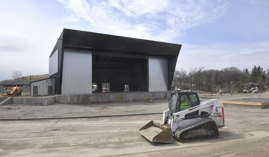 In this Tuesday, April 21, 2020 photo, work continues on the seating area at The Ledge amphitheater in Waite Park, Minn. Construction of the new facility is expected to be completed at the end of May. (Dave Schwarz/St. Cloud Times via AP)