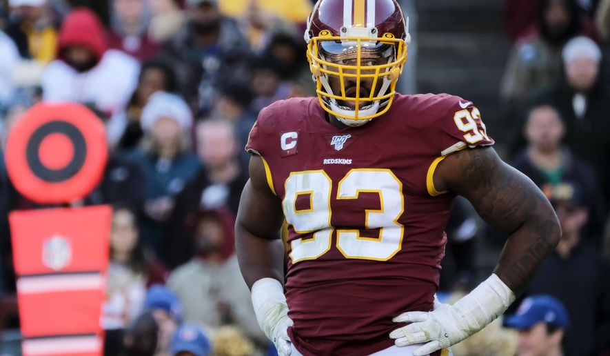 In this Dec. 15, 2019, file photo, Washington Redskins defensive end Jonathan Allen stands on the field during an NFL football game against the Philadelphia Eagles in Landover, Md. The Washington Redskins have exercised the fifth-year option on defensive lineman Jonathan Allen's rookie contract. The team announced the expected move Monday, April 27, 2020, in the aftermath of the NFL draft. (AP Photo/Mark Tenally, File)  **FILE**