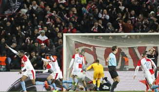 In this file photo taken on Thursday, March 14, 2019, Slavia's Ibrahim-Benjamin Traore, left, celebrates scoring the decisive goal during their Europa League Round of 16 second leg soccer match between Slavia Praha and Sevilla in Prague, Czech Republic. The top two soccer leagues in the Czech Republic are set to restart on May 25, 2020, as the country's has been easing its restrictive measures adopted by the government to contain the coronavirus pandemic. (AP Photo/Petr David Josek, File)