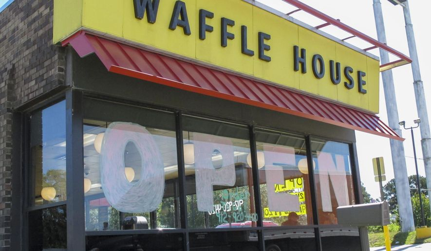 "A Waffle House restaurant has ""OPEN"" painted across its windows on Monday, April 27, 2020 in Savannah, Georgia, as restaurants statewide were allowed to resume dine-in service with restrictions. (AP Photo/Russ Bynum)"