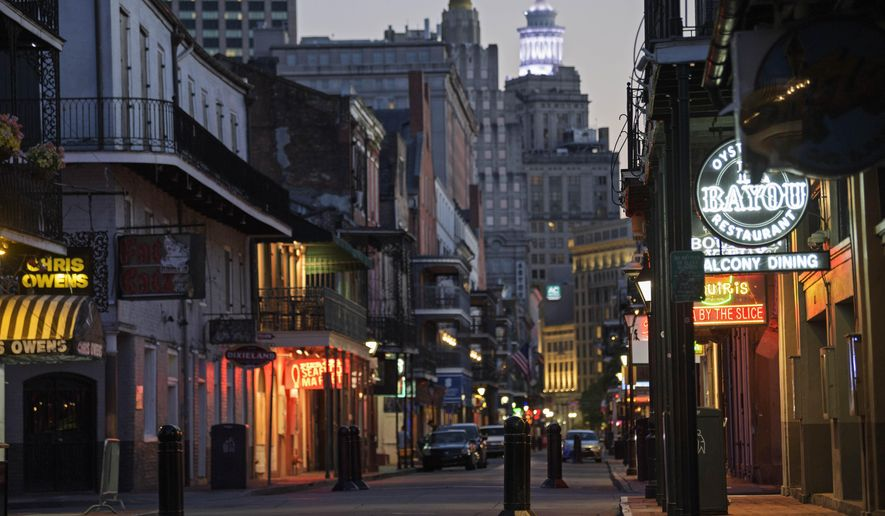 Closed businesses are seen on Bourbon Street due to the coronavirus pandemic, in New Orleans, Friday, April 24, 2020. (Max Becherer/The Advocate via AP)