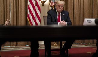 President Donald Trump listens during a meeting with business leaders on coronavirus testing, in the Cabinet Room of the White House, Monday, April 27, 2020, in Washington. (AP Photo/Evan Vucci)