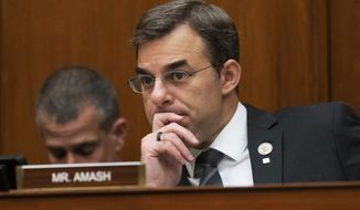 In this June 12, 2019, file photo, Rep. Justin Amash, R-Mich., listens to debate on Capitol Hill in Washington. Amash says he is launching an exploratory committee for the 2020 Libertarian Party's presidential nomination. The Republican-turned-independent said on Twitter, Tuesday, April 28, 2020, that the U.S. is ready for new leadership. (AP Photo/J. Scott Applewhite, File )