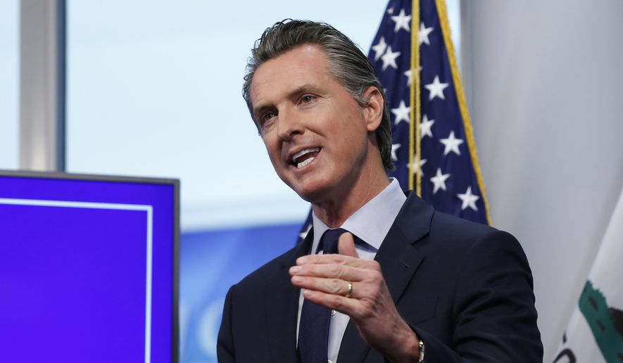 In this Tuesday, April 14, 2020, photo, California Gov. Gavin Newsom speaks during a news conference at the Governor's Office of Emergency Services in Rancho Cordova, Calif. (AP Photo/Rich Pedroncelli) **FILE**