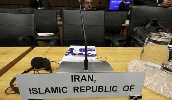 The empty chair of Iran's Ambassador to the International Atomic Energy Agency, IAEA, is pictured prior to the start of the IAEA board of governors meeting at the International Center in Vienna, Austria, Monday, March 9, 2020. (AP Photo/Ronald Zak)