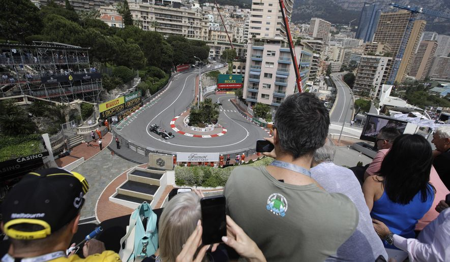 FILE - In this Saturday, May 25, 2019 file photo, spectators watch as Mercedes driver Valtteri Bottas of Finland steers his car during the third free practice at the Monaco racetrack, in Monaco. Formula One's raucous circus won't be coming on May 24, 2020 for the iconic Monaco Grand Prix. The race was canceled on March 19 because of the coronavirus outbreak, with the jewel in F1′s crown removed for the first time in 66 years. (AP Photo/Luca Bruno, File)