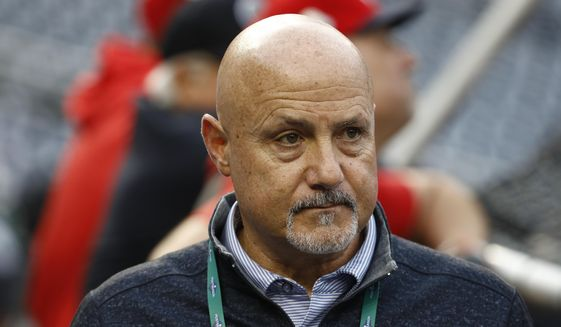 """In this Oct. 26, 2019, file photo, Washington Nationals general manager Mike Rizzo watches batting practice for Game 4 against the Houston Astros in the baseball World Series in Washington. """"The challenges have been that they stopped playing baseball about six weeks into the spring season,"""" Rizzo said, talking about the draft. """"So that's been the biggest hurdle that we had to face. Fortunately, we dive into this draft thing very, very seriously. We got a lot done early on, especially the higher-round type of premier prospects. We have a really good feel of what's out there in the country."""" (AP Photo/Patrick Semansky, File)  **FILE**"""