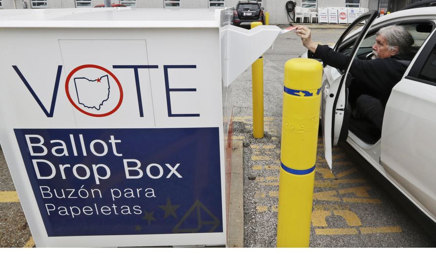 In this April 22, 2020, file photo, a voter drops his election ballot in the drop box at the Cuyahoga County Board of Elections in Cleveland.  The state announced on Aug. 28, 2020, that it will remove up to 115,000 inactive registered voters from the rolls after November's election. (AP Photo/Tony Dejak, File)  **FILE**