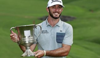FILE - In this May 5, 2019, file photo, Max Homa poses with the trophy after winning the Wells Fargo Championship golf tournament at Quail Hollow Club in Charlotte, N.C. Homa will have to wait two years to defend his title at Quail Hollow because the tournament moves to Bethesda, Md., next year. (AP Photo/Jason E. Miczek, File)