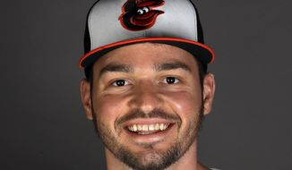 """FILE - This is a 2020 file photo showing Trey Mancini of the Baltimore Orioles baseball team. Orioles outfielder Trey Mancini is undergoing chemotherapy for Stage III colon cancer and expects to miss the 2020 season if major leaguers return this summer. Mancini had the malignant tumor removed shortly before turning 28 on March 18. He has been undergoing chemotherapy since April 13. Writing in the first person for The Players Tribune, Mancini saïd, """"My treatment will take six months — every two weeks for six months. If baseball returns in 2020, it will probably be without me."""" (AP Photo/John Bazemore, File)"""