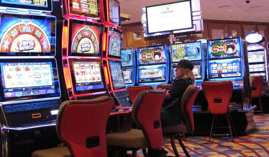 Masks, separated slots, more cleaning once casinos reopen - Washington Times