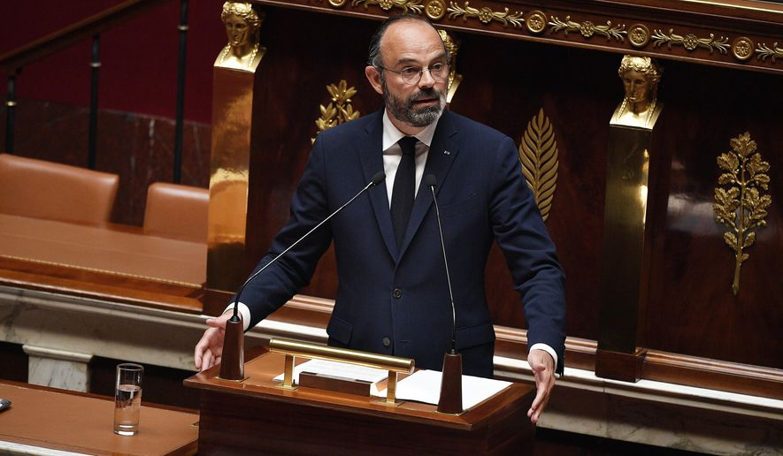 French Prime Minister Edouard Philippe presents his plan to exit from the lockdown at the National Assembly in Paris, Tuesday, April 28, 2020. French Prime Minister Edouard Philippe has outlined a stringent plan to fight coronavirus in France by automatically testing everyone who's come in contact with someone infected with COVID-19. (David Niviere, Pool via AP)