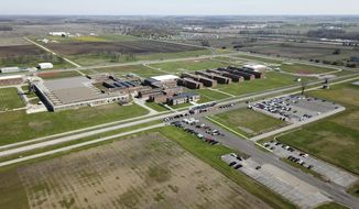 The Marion Correctional Institution is seen near Marion, Ohio, in an aerial photo taken Monday, April 27, 2020. More than 2,000 inmates out of about 2,500 at Marion  have tested positive for the coronavirus, according to the state prisons agency. (Doral Chenoweth/The Columbus Dispatch via AP)