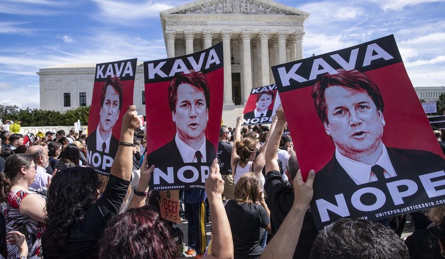 Supreme Court Justice Brett Kavanaugh is a focus of the press with former Vice President Joseph R. Biden accused of sexual misconduct. (Associated Press) ** FILE **