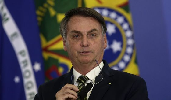 Brazil's President Jair Bolsonaro speaks during the inauguration ceremony of the newly appointed justice minister, at the Planalto presidential palace, in Brasilia, Brazil, Wednesday, April 29, 2020. (AP Photo / Eraldo Peres)