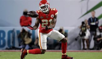 In this Feb. 2, 2020, file photo, Kansas City Chiefs' Bashaud Breeland (21) intercepts a San Francisco 49ers pass during the first half of NFL football's Super Bowl 54 in Miami Gardens, Fla. Breeland was arrested on several charges Tuesday, April 28, in South Carolina, including possessing marijuana or hash, driving with an open container of alcohol and resisting arrest. The 28-year-old Breeland, of Charlotte, N.C., was being held at the York County Jail, according to the facility's online records. (AP Photo/Wilfredo Lee, File)  **FILE**