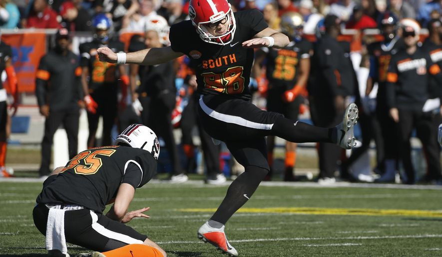 FILE - In this Jan. 25, 2020, file photo, South place kicker Rodrigo Blankenship of Georgia (98) is shown during the first half of the Senior Bowl college football game in Mobile, Ala. The Indianapolis Colts now have two kickers under contract for next season while the NFL's career scoring leader, Adam Vinatieri, remains a free agent. On Wednesday, April 29, 2020, team officials announced they had signed 10 undrafted rookies including Rodrigo Blankenship, one of last season's top college kickers.(AP Photo/Butch Dill, File)