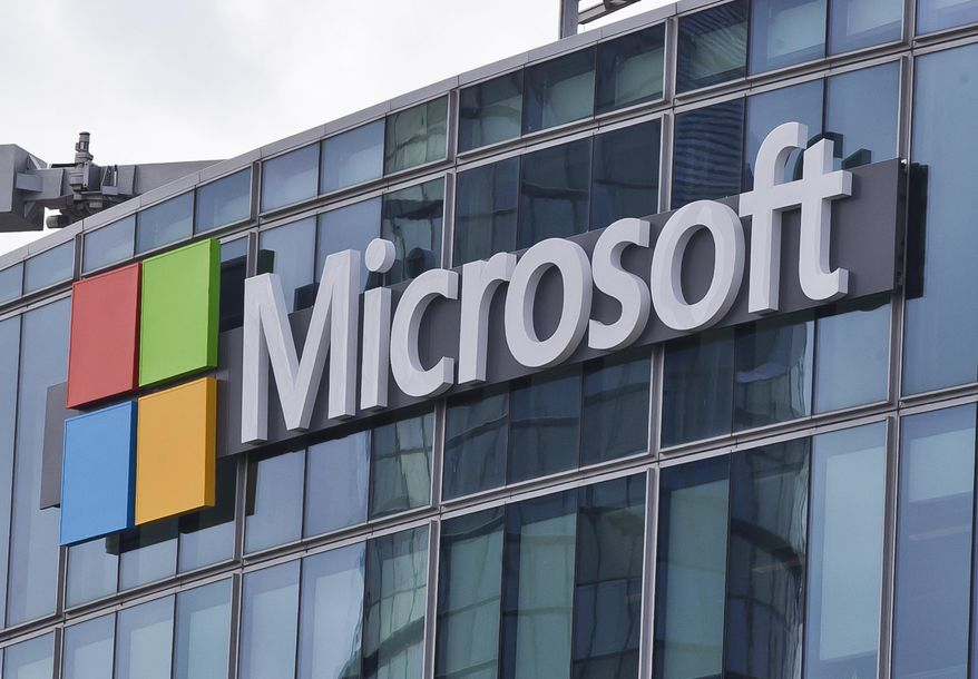 This April 12, 2016, file photo shows the Microsoft logo in Issy-les-Moulineaux, outside Paris, France. (AP Photo/Michel Euler, File)