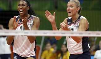FILE - In this Aug. 8, 2016, file photo, United States' Foluke Akinradewo, left, and Jordan Larson celebrate during a women's preliminary volleyball match against Puerto Rico at the 2016 Summer Olympics in Rio de Janeiro, Brazil. The top women's volleyball players in the U.S. will now have their own professional league at home, providing more players an opportunity to prolong their careers past college without having to go overseas. (AP Photo/Matt Rourke, FIle)