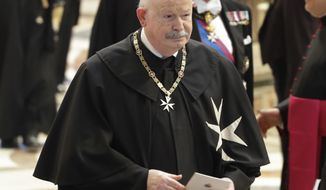 FILE - In this Thursday, June 28, 2018 file photo, Giacomo Dalla Torre del Tempio di Sanguinetto, Prince and Grand Master of the Sovereign Military Order of Malta, attends a consistory in St. Peter's Basilica at the Vatican. Giacomo Dalla Torre del Tempio di Sanguinetto, who steered the ancient Knights of Malta religious order through an institutional crisis with the Vatican as its prince and grand master, has died. He was 75.The order said Dalla Torre died early Wednesday after being diagnosed several months ago with an incurable disease. (AP Photo/Alessandra Tarantino, File)