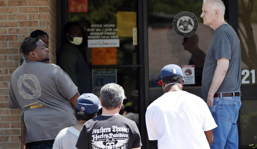 FILE - In this Tuesday, April 21, 2020, file photo, people wait outside a WIN job center in Pearl, Miss. As of mid-April, about 26 million Americans had filed unemployment claims in the first five weeks since governments began ordering people to stay home and some businesses to close as a precaution against spreading the virus that causes the COVID-19 disease. It's already the worst stretch of job losses in U.S. history. New unemployment data to be released Thursday, April 30, 2020, is expected to push that total even higher. (AP Photo/Rogelio V. Solis, File)