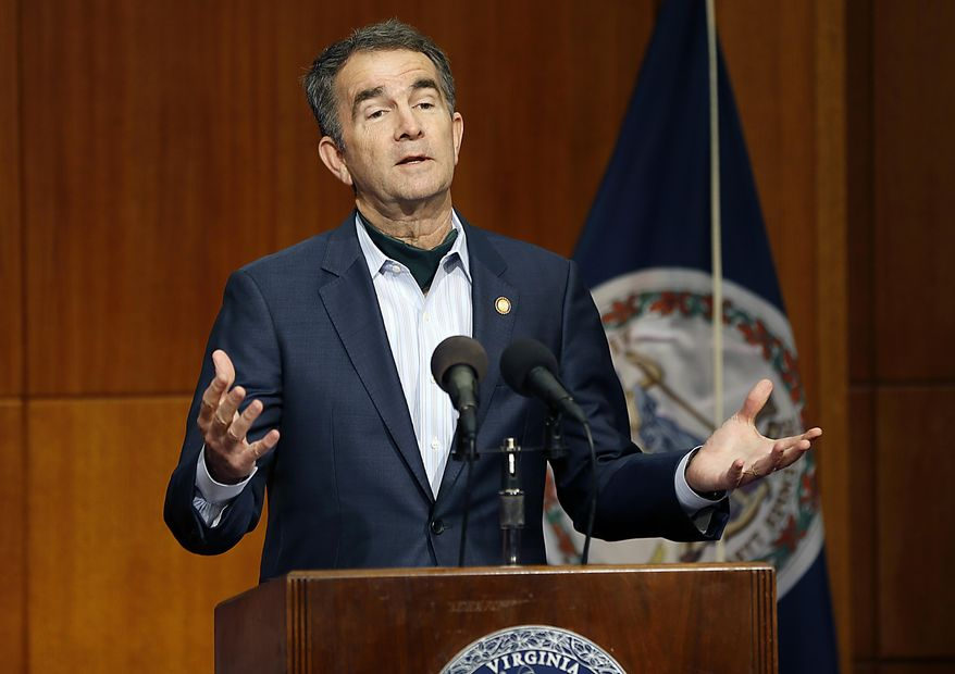 Virginia Gov. Ralph Northam speaks during the COVID-19 update news conference in the Patrick Henry Building Wednesday, April 29, 2020, in Richmond, Va. (Mark Gormus/Richmond Times-Dispatch via AP) ** FILE **