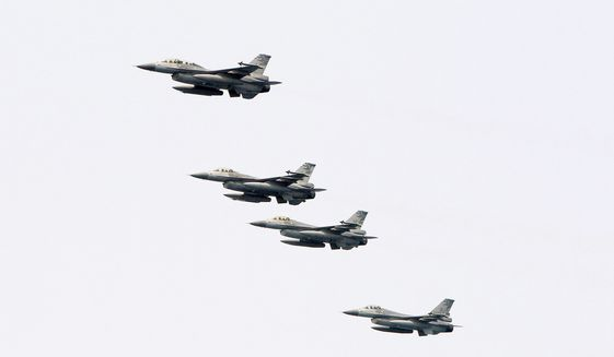 In this April 13, 2018, file photo, Taiwanese F-16 jet fighters fly in close formation during a navy exercise at Suao naval station in Yilan County, northeastern Taiwan. (AP Photo/Chiang Ying-ying, File)