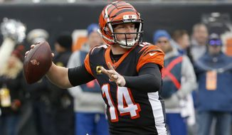 In this Dec. 15, 2019, file photo, Cincinnati Bengals quarterback Andy Dalton passes in the first half of an NFL football game against the New England Patriots in Cincinnati. The Bengals cleared the way for Joe Burrow to lead the team by releasing quarterback Andy Dalton, who holds several of the franchise's passing records but couldn't lead the woebegone Bengals deep into the playoffs. The move Thursday, April 30, 2020, gives Dalton, who had a year left on his deal, a chance to compete for a job with another team. (AP Photo/Frank Victores) ** FILE **
