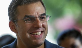In this Aug. 21, 2019, file photo Rep. Justin Amash, I-Cascade Township, holds a constituent meeting at Rising Grinds Cafe, in Grand Rapids, Mich. (Cory Morse/The Grand Rapids Press via AP, File)/The Grand Rapids Press via AP)