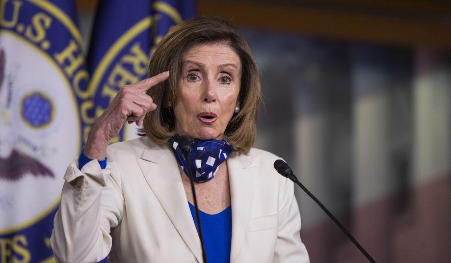 House Speaker Nancy Pelosi of Calif. speaks during a news conference on Capitol Hill Thursday, April 30, 2020, in Washington. (AP Photo/Manuel Balce Ceneta)