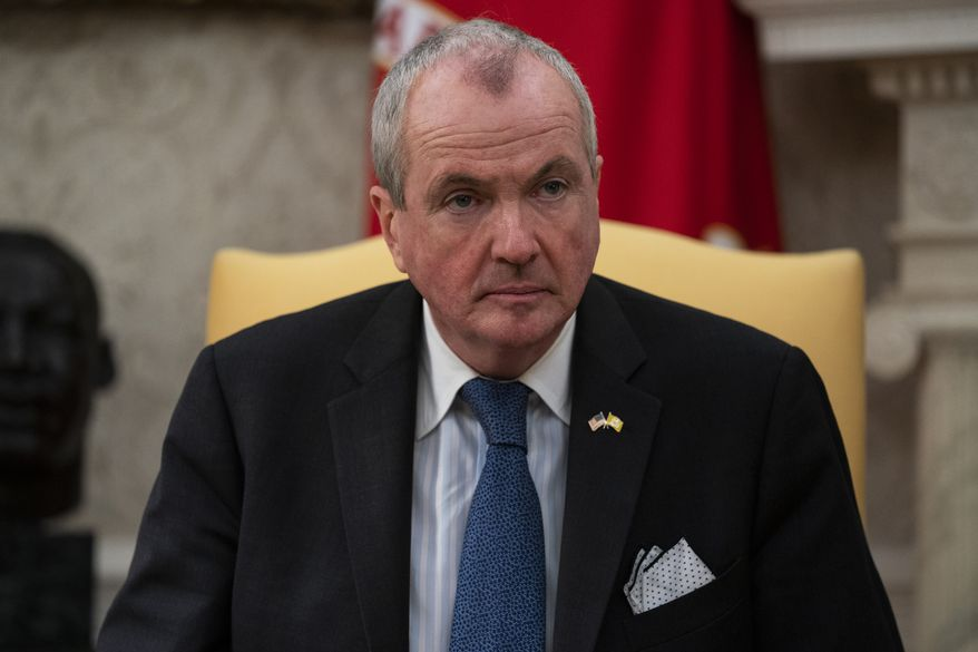 Gov. Phil Murphy, D-N.J., listens to President Donald Trump speak during a meeting about the coronavirus response in the Oval Office of the White House, Thursday, April 30, 2020, in Washington. (AP Photo/Evan Vucci) **FILE**