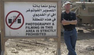 Mark Frerichs, a contractor from Illinois, poses in Iraq in this undated photo obtained from Twitter that he would include with his resume when job hunting. Frerichs was abducted in Afghanistan in January 2020. Early efforts to locate him have been shrouded in mystery and his disappearance has been the subject of minimal public discussion by the U.S. government. The Associated Press has learned that in the days following Frerichs' capture, Navy commandos raided a village and detained suspected members of the Taliban-linked Haqqani network while the U.S. intelligence community tried to track the cellphones of Frerich and his captors. (Twitter via AP)