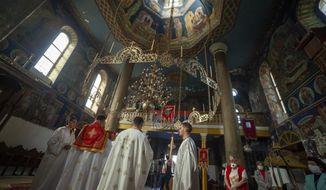 The Orthodox Christian Easter liturgy service is held at a church in Zenica, Central Bosnia, Sunday, April 19, 2020. A small number of faithful attended the service amid the coronavirus pandemic. (AP Photo/Almir Alic)