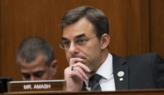 In this June 12, 2019, file photo, Rep. Justin Amash, then a Michigan Republican, listens to debate on Capitol Hill in Washington. Mr. Amash is now calling on anti-Trump Republicans to leave the GOP to become members of the Libertarian Party. (AP Photo/J. Scott Applewhite, File) ** FILE **
