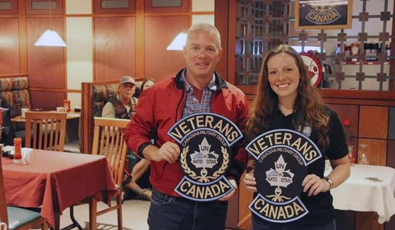 In this undated photo provided by Shane Cowbrough, is Cowbrough and his daughter Sub-Lt. Abbigail Cowbrough, right, of Nova Scotia, who was killed in a military helicopter crash. One person is dead and five are missing after a military helicopter operating off a Canadian frigate during a NATO exercise crashed into the sea between Greece and Italy, Canadian Prime Minister Justin Trudeau said Thursday, April 30, 2020. Gen. Jonathan Vance, Canada's top military official, said the ship lost contact with the aircrew on Wednesday evening and that flares were spotted from the water minutes later. He confirmed the body of Abbigail Cowbrough, 23, has been recovered. (Shane Cowbrough via AP)