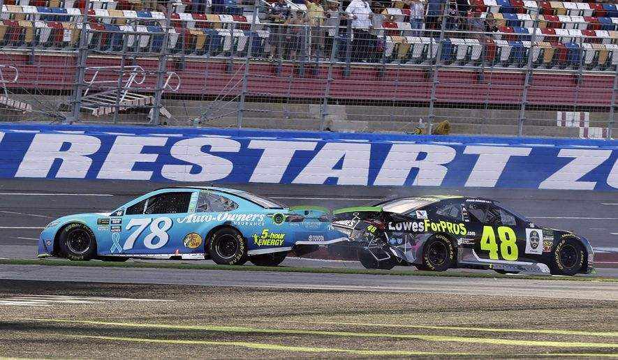 In this Sept. 30, 2018, file photo, Martin Truex Jr., (78) and Jimmie Johnson (48) crash on the final lap during the NASCAR Cup series auto race at Charlotte Motor Speedway in Concord, N.C. Charlotte Motor Speedway will host the Coca-Cola 600 on May 24, 2020, to mark 60 consecutive years the longest race on the NASCAR schedule will be held on Memorial Day weekend. The track in Concord will then host a Wednesday race three days later. (AP Photo/Chuck Burton, File)  ***FILE**