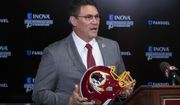 In this Jan. 2, 2020, file photo, Washington Redskins new head coach Ron Rivera holds up a helmet during a news conference at the team's NFL football training facility in Ashburn, Va. The NFL Draft is April 23-25. (AP Photo/Alex Brandon) ** FILE **