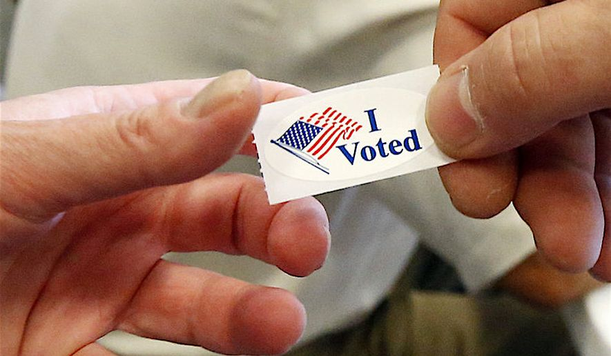A new survey finds that the coronavirus pandemic will have minimum influence on voters' decisions in the poll booth. Two-thirds of voters have already made up their minds. (AP Photo)