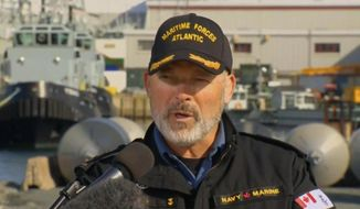 "In this image made from CTV vide, Rear-Admiral Craig Baines, Commander of Maritime Command Component, speaks in a news conference in Halifax, Canada, Thursday, April 30, 2020. ""With tremendous assistance from our NATO allies, four ships including the Fredericton, two Italian ships and one Turkish ship continue to search with ship borne helicopters and fixed-wing patrol aircraft from Italy, the United States and Greece,"" said Baines. (CTV via AP)"