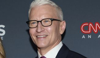 FILE - In this Dec. 8, 2019, file photo, Anderson Cooper attends the 13th annual CNN Heroes: An All-Star Tribute at the American Museum of Natural History in New York. Cooper is a father, a milestone the CNN anchor says for a while he didn't believe would ever happen. Cooper announced the birth of his son, Wyatt, Thursday evening, April 30, 2020, on his show and in a lengthy Instagram post. His son was born on Monday via a surrogate, the newsman said, and is named after his father who died when Cooper was 10. (Photo by Jason Mendez/Invision/AP, File)