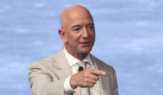 This June 19, 2019, file photo shows Amazon founder Jeff Bezos during the JFK Space Summit at the John F. Kennedy Presidential Library in Boston. (AP Photo/Charles Krupa) ** FILE **