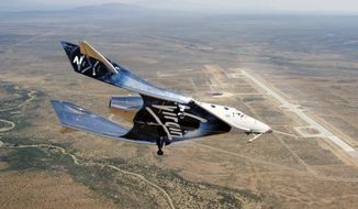 Virgin Galactic SpaceshipTwo Unity flys free in the New Mexico Airspace for the first time on Friday, May 1, 2020. Virgin Galactic's spaceship VSS Unity has landed in the New Mexico desert after its first glide flight from Spaceport America. The company announced Friday's flight on social media, sharing photos of the spaceship. (Virgin Galactic via AP)