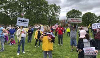 Protesters rally outside Delaware's Statehouse on Friday, May 1, 2020, in Dover, Del., a demonstration organized by a group called Delawareans Against Excessive Quarantine to demand that Gov. John Carney lift restrictions he has imposed on businesses and individuals in an effort to stem the spread of the coronavirus. A similar rally was held outside the state office building in Wilmington. Carney said the protesters had a right to express their opinion, but that he would have hoped they were more appreciative and supportive of what state officials have done in responding to the virus. (AP Photo/Randall Chase)