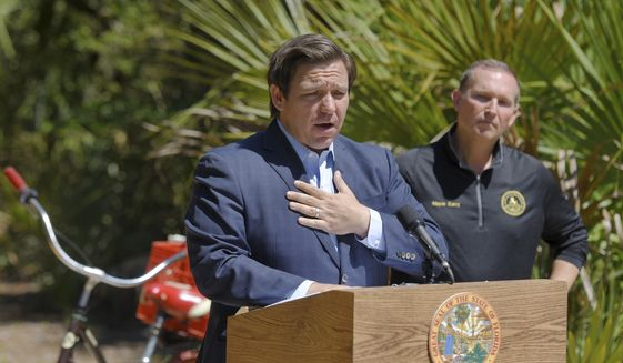 Florida Gov. Ron DeSantis speaks during a news conference alongside Jacksonville Mayor Lenny Curry at Little Talbot Island State Park Friday, May 1, 2020. (Bob Self/The Florida Times-Union via AP) ** FILE **